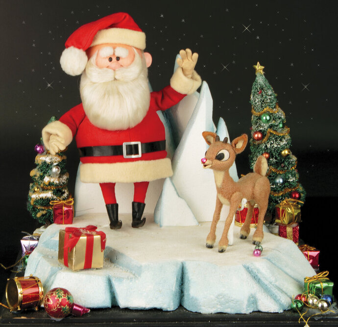 This image released by Profiles in History shows a Santa Clause and Rudolph reindeer puppet used in the filming of the 1964 Christmas special