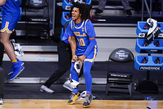 UCLA guard Tyger Campbell (10) reacts to a play against Alabama in the first half of a Sweet 16 game in the NCAA men's college basketball tournament at Hinkle Fieldhouse in Indianapolis, Sunday, March 28, 2021. (AP Photo/Michael Conroy)