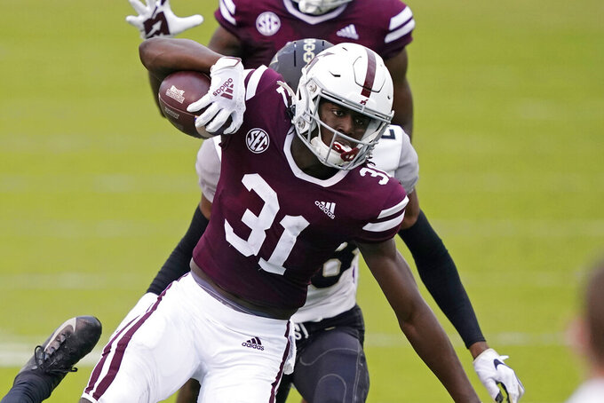 Mississippi State wide receiver Jaden Walley (31) stretches for extra yards after catching a short pass in front of a Vanderbilt defender during the first half of an NCAA college football game in Starkville, Miss., Saturday, Nov. 7, 2020. (AP Photo/Rogelio V. Solis)