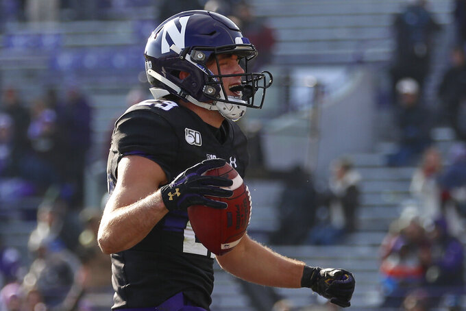 Hull scores 4 TDs, Northwestern routs UMass 45-6