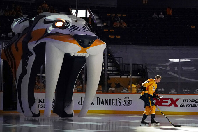 Nashville Predators left wing Cole Smith (36) is introduced before the team's season-opening NHL hockey game against the Columbus Blue Jackets Thursday, Jan. 14, 2021, in Nashville, Tenn. The game is played before a limited number of fans. (AP Photo/Mark Humphrey)