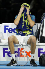 Daniil Medvedev of Russia sits in his chair in a break during the ATP World Tour Finals singles tennis match against Rafael Nadal of Spain at the O2 Arena in London, Wednesday, Nov. 13, 2019. (AP Photo/Kirsty Wigglesworth)