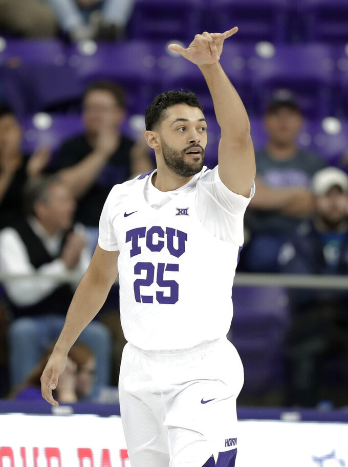 TCU guard Alex Robinson (25) celebrates sinking a three-point basket in the first half of an NCAA college basketball game against Kansas State in Fort Worth, Texas, Monday, March 4, 2019. (AP Photo/Tony Gutierrez)