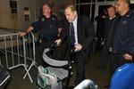 Harvey Weinstein leaves his rape trial, in New York, Friday, Jan. 24, 2020.