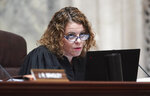 Wisconsin Supreme Court Justice Rebecca Dallet listens during oral arguments before the Wisconsin Supreme Court in 2019AP559, League of Women Voters v. Tony Evers at the Wisconsin State Capitol in Madison, Wisconsin Wednesday, May 15, 2019. (Steve Apps/Wisconsin State Journal via AP)