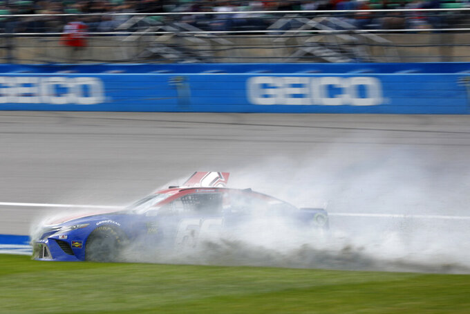 Timmy Hill (66) spins into the infield during a NASCAR Cup Series auto race at Kansas Speedway in Kansas City, Kan., Sunday, Oct. 20, 2019. (AP Photo/Colin E. Braley)