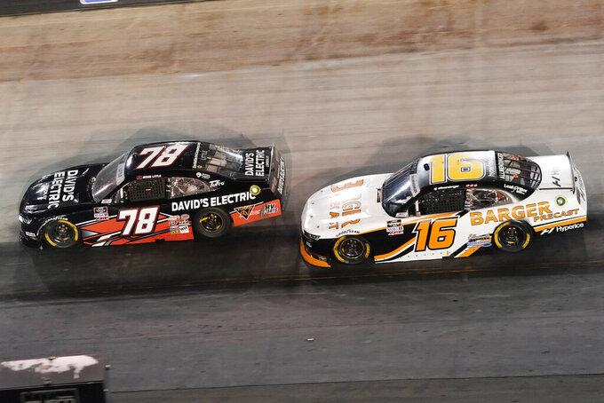 AJ Allmendinger (16) follows Jesse Little (78) through a turn during a NASCAR Xfinity Series auto race at Bristol Motor Speedway Friday, Sept. 17, 2021, in Bristol, Tenn. (AP Photo/Mark Humphrey)