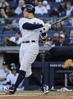 New York Yankees' Aaron Judge hits an RBI single during the third inning of a baseball game against the Detroit Tigers Wednesday, April 3, 2019, in New York. (AP Photo/Frank Franklin II)