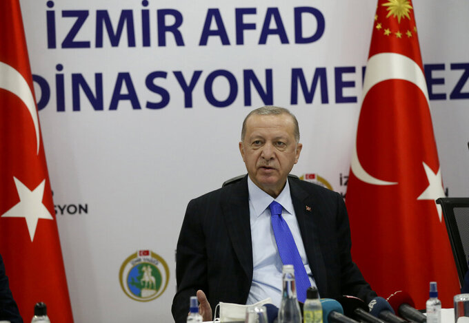 Turkey's President Recep Tayyip Erdogan speaks at Izmir AFAD emergency response center, in Izmir, Turkey, Saturday, Oct. 31, 2020.  Three young children and their mother were rescued alive from the rubble of a collapsed building in western Turkey on Saturday, some 23 hours after a powerful earthquake in the Aegean Sea killed several people and injured more than 800 others.(Turkish Presidency via AP, Pool)