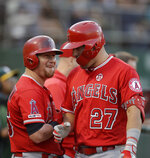 Los Angeles Angels' Mike Trout, right, is congratulated by Kole Calhoun after hitting a home run off Oakland Athletics pitcher Mike Fiers during the first inning of a baseball game Tuesday, Sept. 3, 2019, in Oakland, Calif. (AP Photo/Ben Margot)
