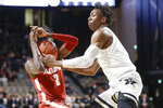 Alabama guard Kira Lewis Jr. (2) and Vanderbilt guard Saben Lee battle for the ball in the second half of an NCAA college basketball game Wednesday, Jan. 22, 2020, in Nashville, Tenn. (AP Photo/Mark Humphrey)