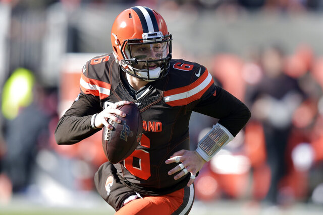 """FILE - In this Nov. 24, 2019, file photo, Cleveland Browns quarterback Baker Mayfield (6) looks to pass in the first quarter of an NFL football game against the Miami Dolphins in Cleveland. On Friday, jan. 31, 2020, Mayfield, who struggled from the outset while the Browns had a disappointing 6-10 season, went face to face with one one of his biggest critics, former NFL coach Rex Ryan and current ESPN analyst, who called the former No. 1 overall pick """"overrated as hell"""" and felt he regressed after a rocking first year when he broke the league rookie record for touchdown passes. (AP Photo/David Richard, File)"""