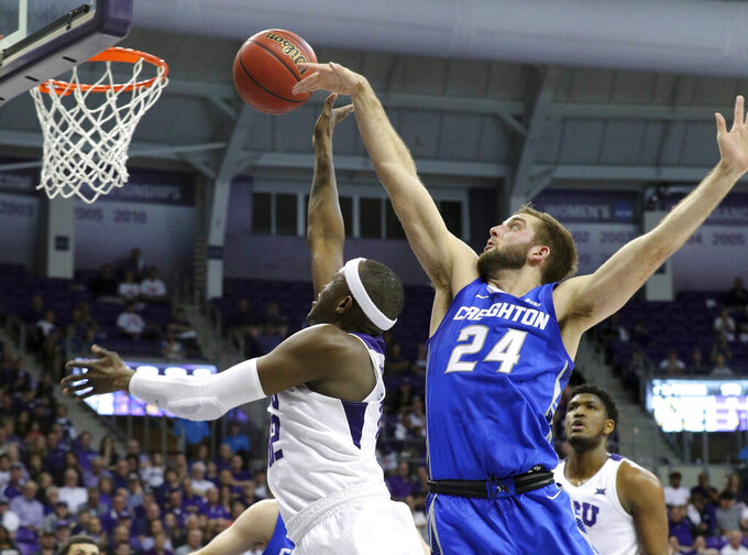 TCU forward Kouat Noi (12) puts up a shot against Creighton guard Mitch Ballock (24) in the second half of an NCAA college basketball game in Fort Worth, Texas, Tuesday, March 26, 2019. TCU won, 71-58. (Richard W. Rodriguez/Star-Telegram via AP)