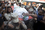 Members of the Hamas security forces carry the body of their colleague, Mahmoud al-Adham, 28, during his funeral in Town of Jabaliya, northern Gaza Strip, Thursday, July 11, 2019. Hamas' armed wing said Thursday that the Israeli army