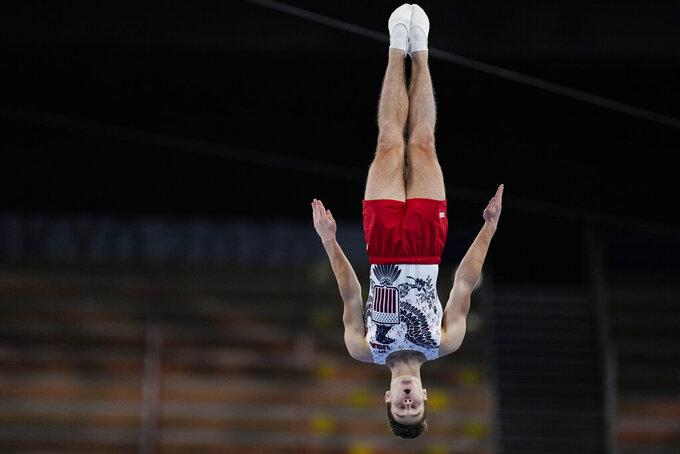 Aliaksei Shostak, of United States, competes in the men's trampoline gymnastics qualifier at the 2020 Summer Olympics, Saturday, July 31, 2021, in Tokyo. (AP Photo/Natacha Pisarenko)