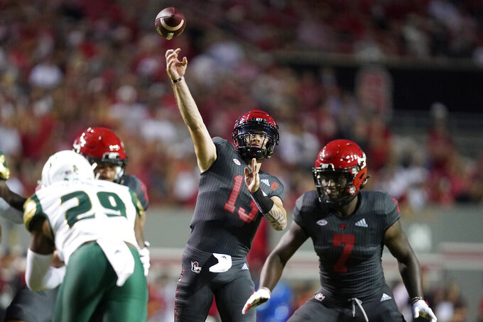 North Carolina State quarterback Devin Leary (13) throws a pass against South Florida during the first half of an NCAA college football game in Raleigh, N.C., Thursday, Sept. 2, 2021. (AP Photo/Gerry Broome)