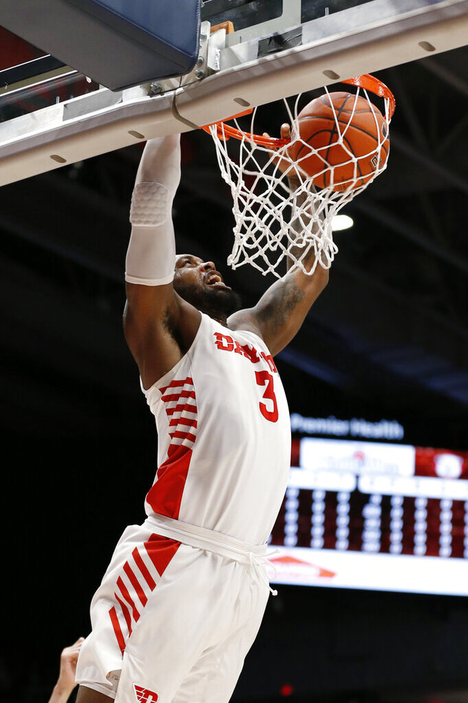 Dayton guard Trey Landers dunks against Davidson during the first half of an NCAA college basketball game Friday, Feb. 28, 2020, in Dayton, Ohio. (AP Photo/Gary Landers)
