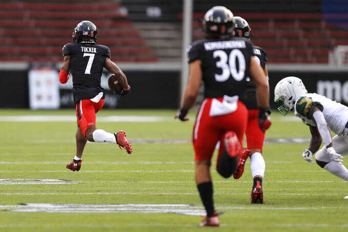 Cincinnati wide receiver Tre Tucker (7) carries the ball for a touchdown on a kick-return during the second half of an NCAA college football game against South Florida, Saturday, Oct. 3, 2020, in Cincinnati. (AP Photo/Aaron Doster)