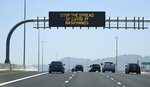 The Arizona Department of Transportation posts new signage on along highways urging the public to wash hands due to the recent surge in coronavirus cases Sunday, June 21, 2020, in Phoenix. (AP Photo/Ross D. Franklin)