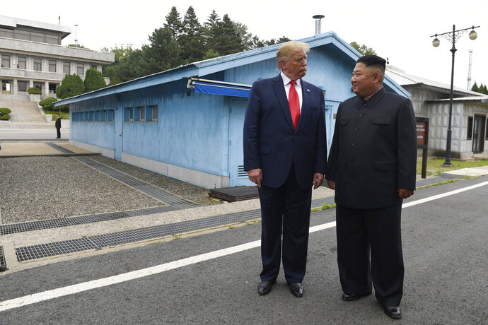 FILE - In this June 30, 2019, file photo, U.S. President Donald Trump, left, meets with North Korean leader Kim Jong Un at the border village of Panmunjom in Demilitarized Zone, South Korea. North Korea on Tuesday, Nov. 5, 2019, said the U.S. redesignation of Pyongyang as a sponsor of terrorism is dimming prospects for nuclear diplomacy between the countries. (AP Photo/Susan Walsh, File)
