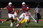 Arizona quarterback Grant Gunnell (17) prepares to stiff-arm Southern California linebacker Ralen Goforth (10) in the first half during an NCAA college football game, Saturday, Nov. 14, 2020, in Tucson, Ariz. (AP Photo/Rick Scuteri)