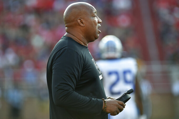 Hampton coach Robert Prunty watches the team' college football game against Liberty in Lynchburg, Va., Saturday, Sept. 21, 2019. (Taylor Irby/The News & Advance via AP)