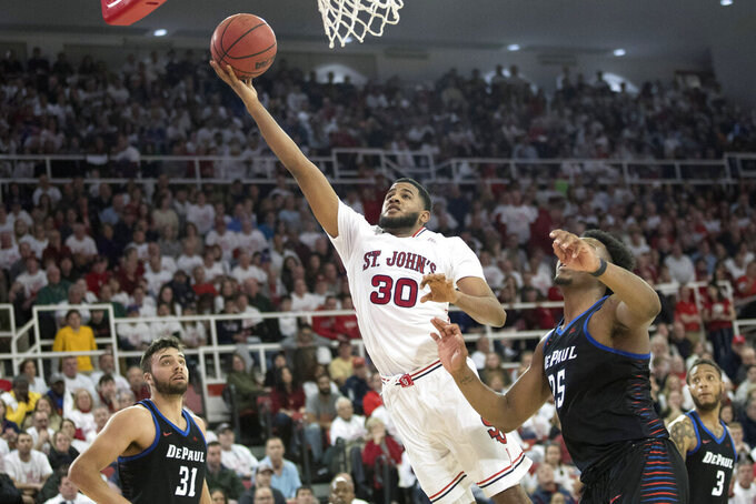 St. John's guard LJ Figueroa (30) goes to the basket past DePaul forward Femi Olujobi (25) and guard Max Strus (31) in the second half of an NCAA college basketball game, Saturday, Jan. 12, 2019, in New York. DePaul won 79-71. (AP Photo/Mary Altaffer)