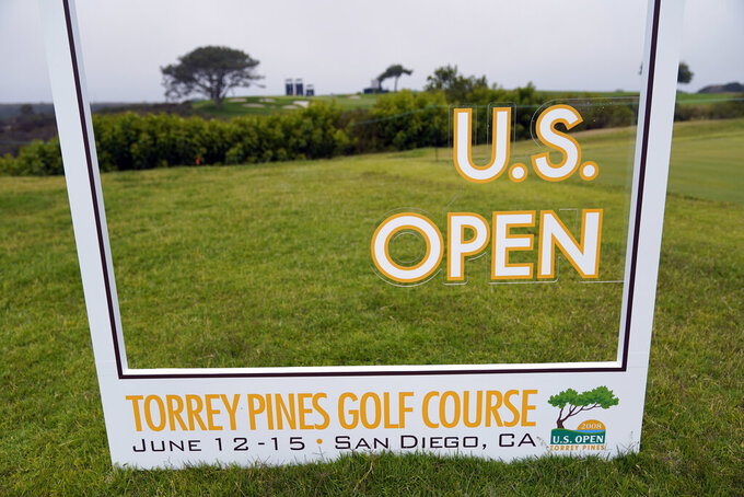 A sign sits along the 16th hole during a practice round of the U.S. Open Golf Championship Monday, June 14, 2021, at Torrey Pines Golf Course in San Diego. (AP Photo/Gregory Bull)