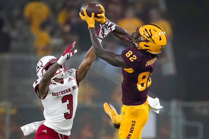 Arizona State wide receiver Andre Johnson (82) pulls in a pass as Southern Utah cornerback Kobe Singleton (3) defends during the first half of an NCAA college football game, Thursday, Sept. 2, 2021, in Tempe, Ariz. (AP Photo/Matt York)