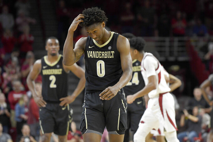 Vanderbilt guard Saben Lee (0) reacts after being called for an offensive against Arkansas during the second half of an NCAA college basketball game, Tuesday, Feb. 5, 2019 in Fayetteville, Ark. (AP Photo/Michael Woods)