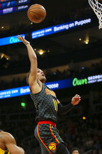 Atlanta Hawks guard Trae Young (11) shoots in the first half of an NBA basketball game against the Indiana Pacers, Friday, Dec. 13, 2019, in Atlanta. (AP Photo/Brett Davis)