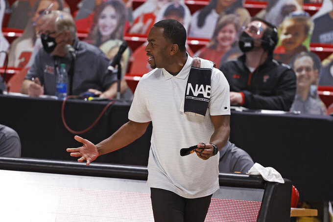 Oklahoma State coach Mike Boynton Jr. yells to his team during the first half of an NCAA college basketball game against Texas Tech, Saturday, Jan. 2, 2021, in Lubbock, Texas. (AP Photo/Brad Tollefson)