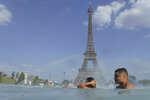 People cool off in the fountain of the Trocadero, as the Eiffel Tower is visible in background, in Paris, Tuesday, June 25, 2019. Authorities warned that temperatures could top 40 degrees Celsius (104 Fahrenheit) in some parts of Europe over the coming days, the effect of hot air moving northward from Africa. French Health Minister Agnes Buzyn said more than half of France is on alert for high temperatures Tuesday and the hot weather is expected to last until the end of the week. (AP Photo/Alessandra Tarantino)