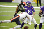 Minnesota Vikings quarterback Kirk Cousins (8) fumbles as he is hit by Chicago Bears linebacker Robert Quinn, left, during the first half of an NFL football game, Sunday, Dec. 20, 2020, in Minneapolis. (AP Photo/Bruce Kluckhohn)