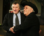 "FILE - In this Jan. 27, 2005, file photo, Robert De Niro, left, and boxer Jake LaMotta stand for photographers before watching a 25th anniversary screening of the movie ""Raging Bull,"" in New York. The Associated Press has compiled a list of the best sports movies ever made — a one-of-a-kind AP Top 25. Seventy writers and editors who work for the company around the world participated in the vote.  (AP Photo/Julie Jacobson, File)"