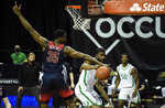 Arizona center Christian Koloko (35) tries to block the pass of Oregon guard LJ Figueroa (12) during the second half of an NCAA college basketball game Monday, March 1, 2021, in Eugene, Ore. (AP Photo/Andy Nelson)