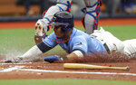 Tampa Bay Rays' Yandy Diaz slides in to score on a sacrifice fly from Joey Wendle against the Texas Rangers during the second inning of a baseball game Sunday, June 30, 2019, in St. Petersburg, Fla. (AP Photo/Mike Carlson)