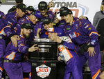 Denny Hamlin, center front, poses for a photo with his crew members after winning the NASCAR Daytona 500 auto race at Daytona International Speedway, Sunday, Feb. 17, 2019, in Daytona Beach, Fla. (AP Photo/Terry Renna)