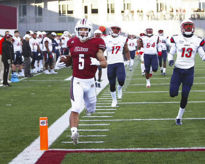 Massachusetts' Andy Isabella (5) runs into the end zone against Liberty defenders in the first half of an NCAA college football game in Amherst, Mass., Saturday, Nov. 3, 2018. (J. Anthony Roberts/The Republican via AP)