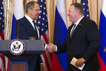 Secretary of State Mike Pompeo, right, shake hands with Russian Foreign Minister Sergey Lavrov, after a media availability at the State Department, Tuesday, Dec. 10, 2019, in Washington. (AP Photo/Alex Brandon)