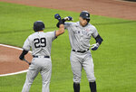 New York Yankees' Aaron Judge, right, celebrates with Gio Urshela (29) after hitting a two-run home run off Baltimore Orioles starting pitcher Jorge Lopez baseball game Saturday, May 15, 2021, in Baltimore. (AP Photo/Terrance Williams)