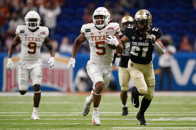 Texas running back Bijan Robinson (5) carries during the first half against Colorado in the Alamo Bowl NCAA college football game Tuesday, Dec. 29, 2020, in San Antonio. (AP Photo/Eric Gay)