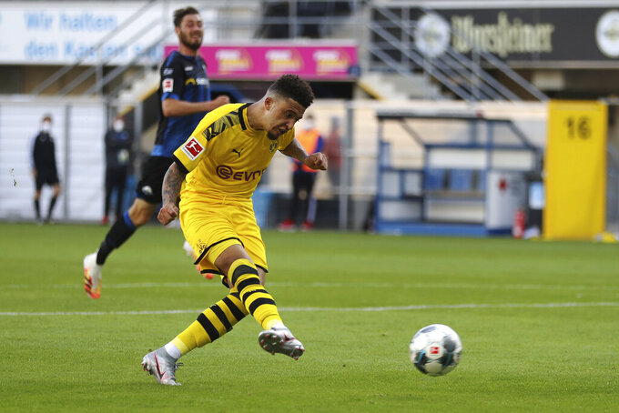 Jadon Sancho of Borussia Dortmund scores his teams sixth goal during the German Bundesliga soccer match between SC Paderborn 07 and Borussia Dortmund at Benteler Arena in Paderborn, Germany, Sunday, May 31, 2020. Because of the coronavirus outbreak all soccer matches of the German Bundesliga take place without spectators. (Lars Baron/Pool via AP)
