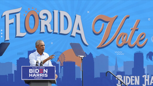 Former President Barack Obama speaks at a rally while campaigning for Democratic presidential candidate former Vice President Joe Biden Tuesday, Oct. 27, 2020, in Orlando, Fla. (AP Photo/John Raoux)