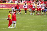 Kansas City Chiefs quarterback Patrick Mahomes stands next to head coach Andy Reid as the team runs drills during an NFL football training camp Saturday, July 31, 2021, in St. Joseph, Mo. (AP Photo/Ed Zurga)