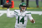 FILE - In this Sunday, Jan. 3, 2021, file photo New York Jets quarterback Sam Darnold rolls out to pass against the New England Patriots in the first half of an NFL football game in Foxborough, Mass. The New York Jets traded Darnold Monday, April 5, 2021, to the Carolina Panthers, ending a stint that was marked by a few flashes of brilliance, inconsistent play, and unfortunate injuries. (AP Photo/Charles Krupa, File)