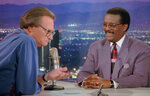 FILE - In this Oct. 4, 1995 file photo, Defense attorney Johnnie Cochran Jr., right, sits for an interview with Larry King, the host of the