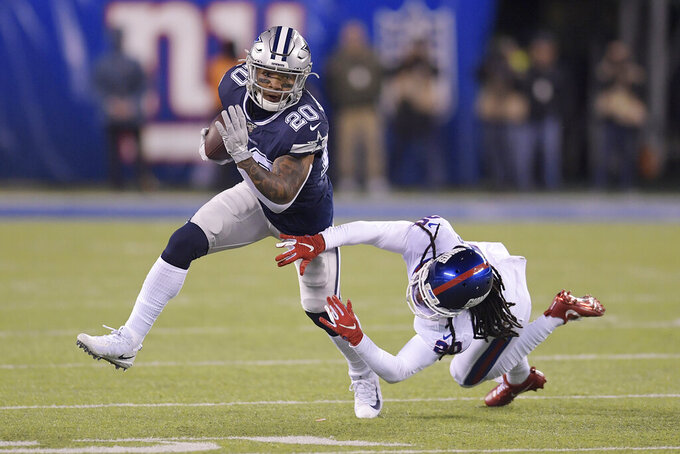 Dallas Cowboys running back Tony Pollard (20) avoids a tackle by New York Giants cornerback Janoris Jenkins (20) during the second quarter of an NFL football game, Monday, Nov. 4, 2019, in East Rutherford, N.J. (AP Photo/Bill Kostroun)
