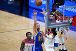Golden State Warriors guard Stephen Curry (30) shoots against New Orleans Pelicans center Steven Adams in the first half of an NBA basketball game in New Orleans, Tuesday, May 4, 2021. (AP Photo/Gerald Herbert)
