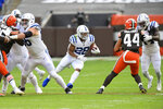 Indianapolis Colts running back Jonathan Taylor rushes during the first half of an NFL football game against the Cleveland Browns, Sunday, Oct. 11, 2020, in Cleveland. (AP Photo/David Richard)